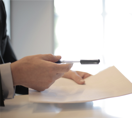 man in suit holding a piece of paper to sign landlord accounts